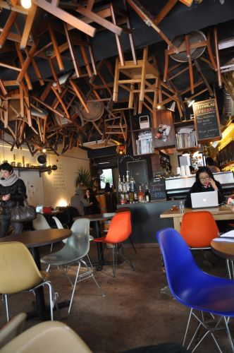 Coffee Lab interior with chairs hanging from the ceiling